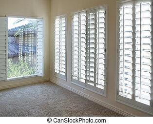 White wood plantation style shutter