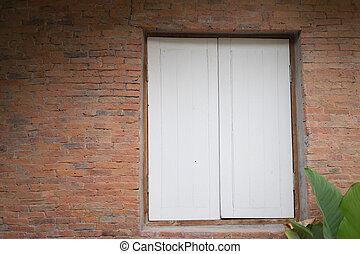 wood window on clay brick wall