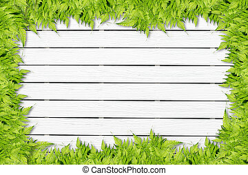White Wooden background with green grass border