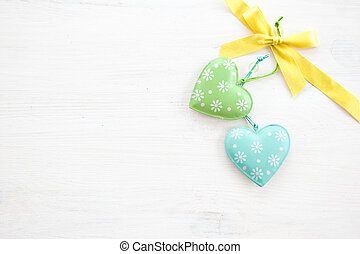 White wooden background with hearts