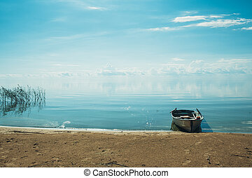 White wooden boat on the lake.