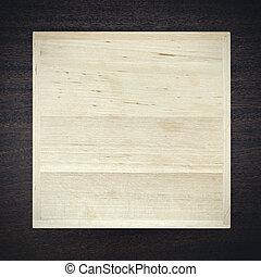 White wooden box on dark background