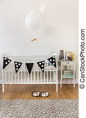 White wooden crib - Photo of white wooden crib in kid room
