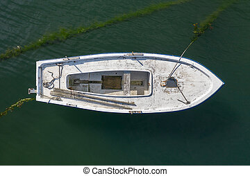white wooden fishing boat anchored, top view