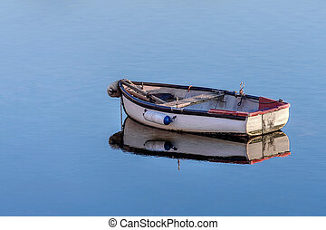 wooden fishing boat in a calm sea