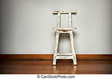 White Wooden Stool Against Wall