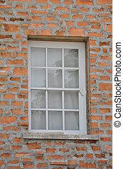 white wooden window on brick wall