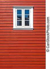 White wooden window on the red wooden house wall - White...
