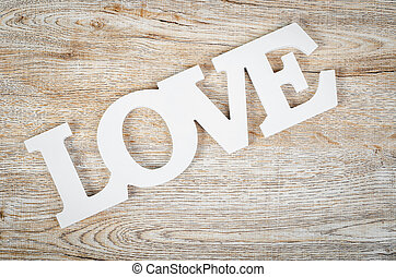 White wooden word love on wooden.