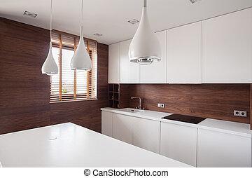 White worktop in bright kitchen