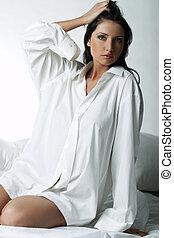 White XXL Shirt - Beautiful brunette woman on bed, wearing ...