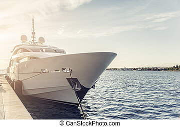 White yacht at the marina. - White yacht at the marina in...