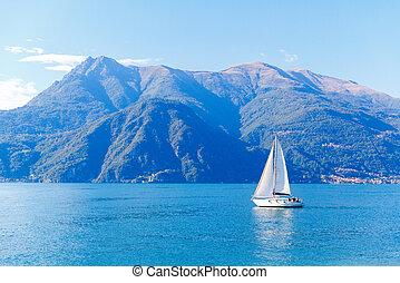 White yacht on lake Como, Varenna, Italy.