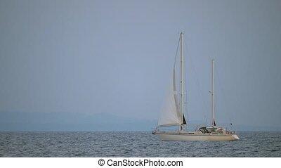 White yacht sailing in quiet sea - Scene with quiet blue...