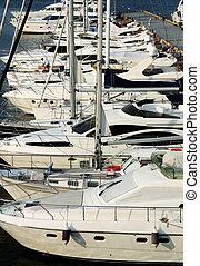 white yachts at berth