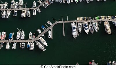 white yachts at the berths in the seaport, aerial view from drone 4