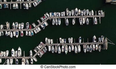 white yachts at the berths in the seaport, aerial view from drone 6