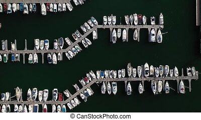 white yachts at the berths in the seaport, aerial view from drone 7