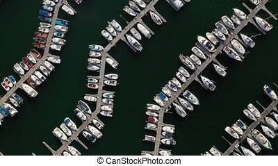 white yachts at the berths in the seaport, aerial view from drone 8