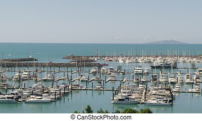 White yachts in pier - A pan to right shot of a pier. White...