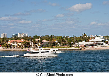 White Yachts Past Coastal Property