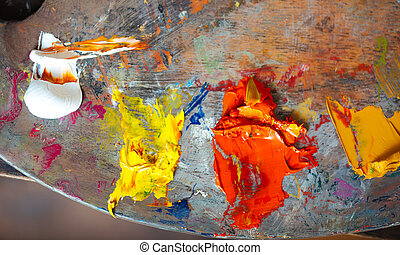 White yellow and orange paints on a palette