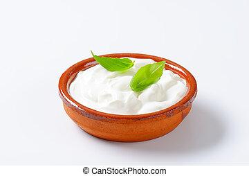 white yogurt in a ceramic bowl