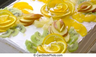 White yummy cake decorated with fruits. Fresh fruits cake...