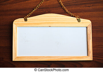 Whiteboard on wood background