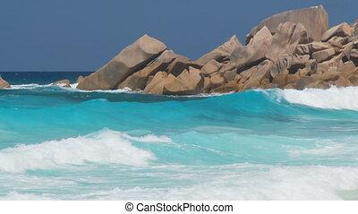 whitecaps in front of rocks