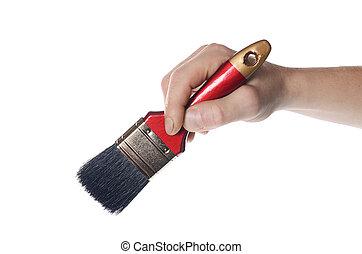 Whitewashing brush in a man's hand