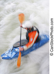 Whitewater - A motion blurred shot of a kayaker in...