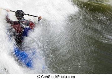 Whitewater - A slow shutterspeed shot of a kayaker in very...
