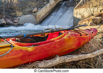 whitewater kayak and water inlet - whitewater kayak at a dam...