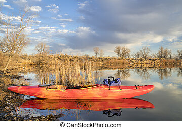 whitewater kayak on lake - whitewater kayak on a calm lake...