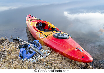 whitewater kayak on lake - whitewater kayak on a lake shore...