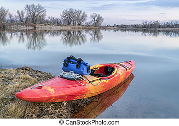 whitewater kayak on lake - whitewater kayak on a lake shore ...
