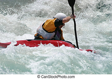 Extreme action - A kayaker battling strong rapids