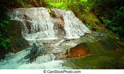 """Whitewater Pouring down a Natural Waterfall in Southeast..."