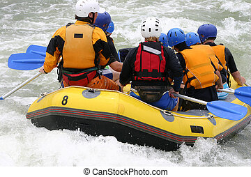 A group whitewater rafting