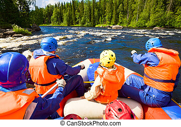 Whitewater rafting - Rafters in a rafting boat on Pistojoki ...