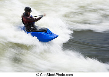 Whitewater Surfing - A slow shutterspeed shot of a kayaker...