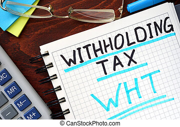 Whithholding tax WHT concept written in a notebook on a wooden table.