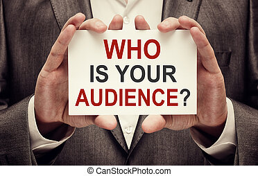 Who is your audience. Card with text in businessman hands
