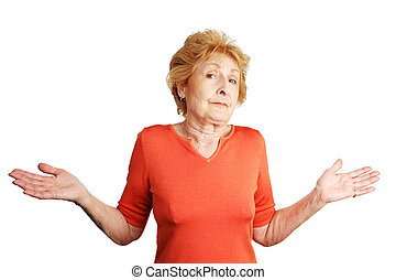 Pretty red haired senior lady shrugging and throwing up her hands in confusion. Isolated on white.
