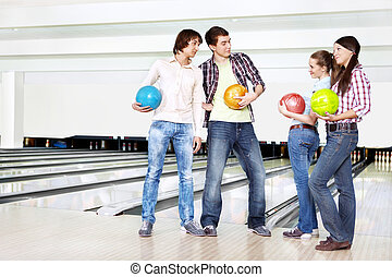 Who will win? - Two young men near to two girls