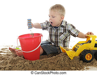 Whoa! Look at That! - A preschooler playing in sand. He's ...