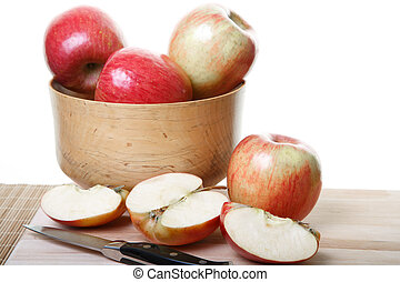 Whole and Cut Apples on Board