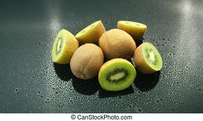 Whole and cut kiwifruit on table - From above fresh ripe...