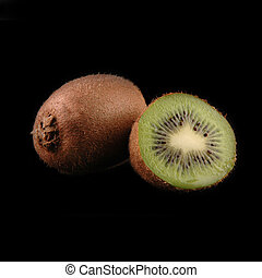 whole and cuted kiwi macro on black